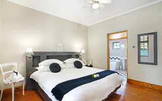 Bedroom with original oregan wood floors and authentic doors and frames